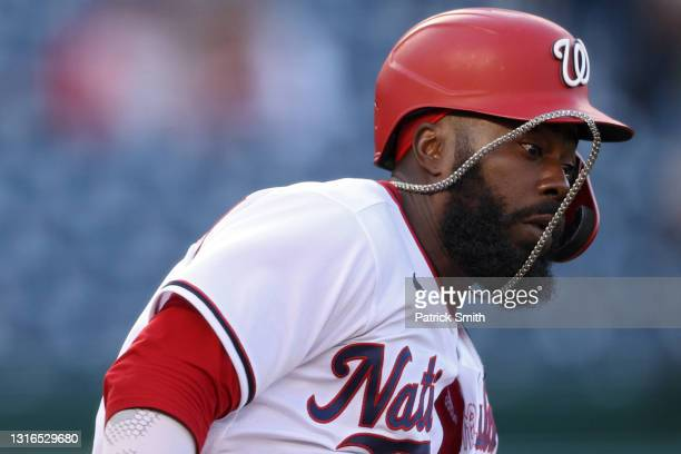 Josh Harrison of the Washington Nationals runs to first base against the Atlanta Braves during the first inning at Nationals Park on May 5, 2021 in...