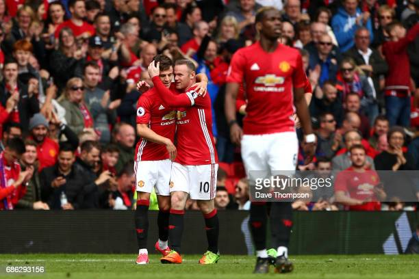 Josh Harrop o Manchester United celebrates scoring his sides first goal with Wayne Rooney of Manchester United during the Premier League match...