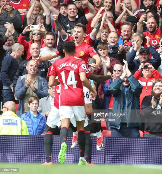 Josh Harrop of Manchester United celebrates scoring their first goal during the Premier League match between Manchester United and Crystal Palace at...