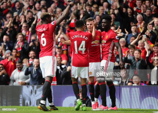Josh Harrop of Manchester United celebrates with his team mates after scoring a goal to make it 10 during the Premier League match between Manchester...