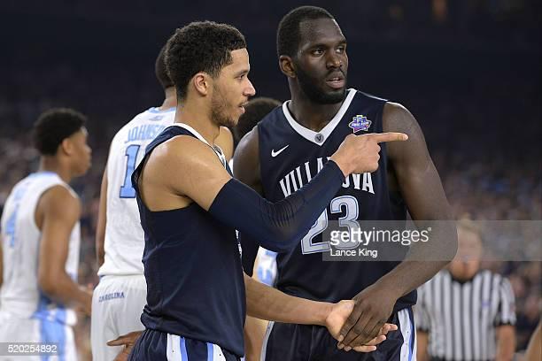 Josh Hart and Daniel Ochefu of the Villanova Wildcats react against the North Carolina Tar Heels during the 2016 NCAA Men's Final Four Championship...