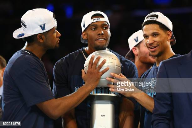 Josh Hart Kris Jenkins and Darryl Reynolds of the Villanova Wildcats celebrate after defeating the Creighton Bluejays to win the Big East Basketball...