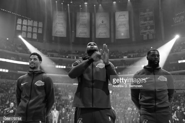 Josh Hart LeBron James and Lance Stephenson of the Los Angeles Lakers stand for the national anthem before the game against the Memphis Grizzlies on...