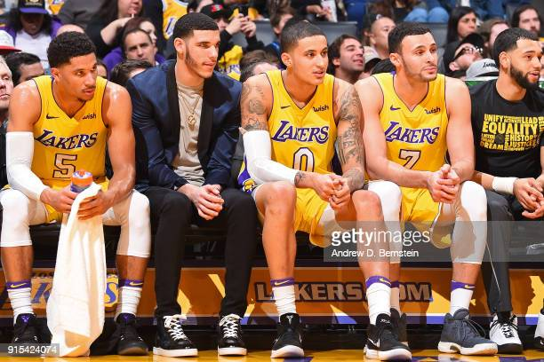 Josh Hart Lonzo Ball Kyle Kuzma and Larry Nance Jr #7 of the Los Angeles Lakers sit on the bench during the game against the Phoenix Suns on February...