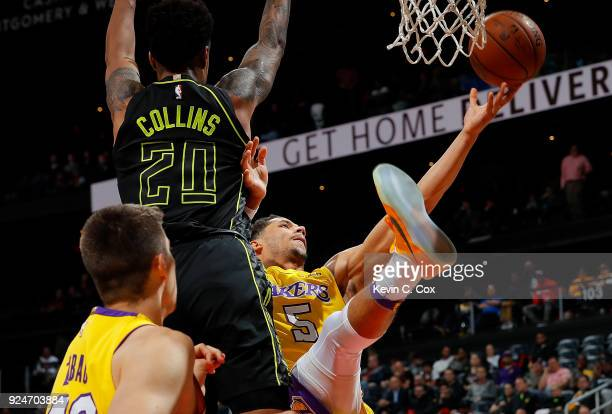 Josh Hart of the Los Angeles Lakers attacks the basket against John Collins of the Atlanta Hawks at Philips Arena on February 26 2018 in Atlanta...