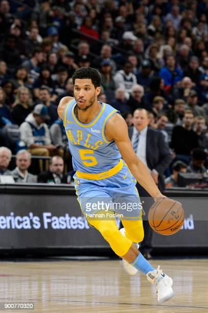 Josh Hart of the Los Angeles Lakers drives to the basket against the Minnesota Timberwolves during the game on January 1 2018 at the Target Center in...