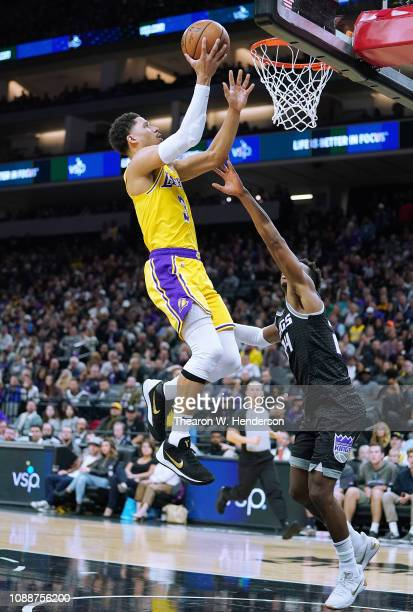 Josh Hart of the Los Angeles Lakers goes up to shoot over Buddy Hield of the Sacramento Kings during an NBA basketball game at Golden 1 Center on...