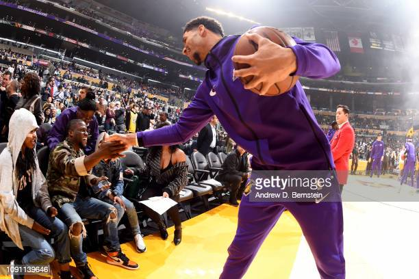 Josh Hart of the Los Angeles Lakers hifives Comedian Kevin Hart before the game against the Philadelphia 76ers on January 21 2019 at STAPLES Center...