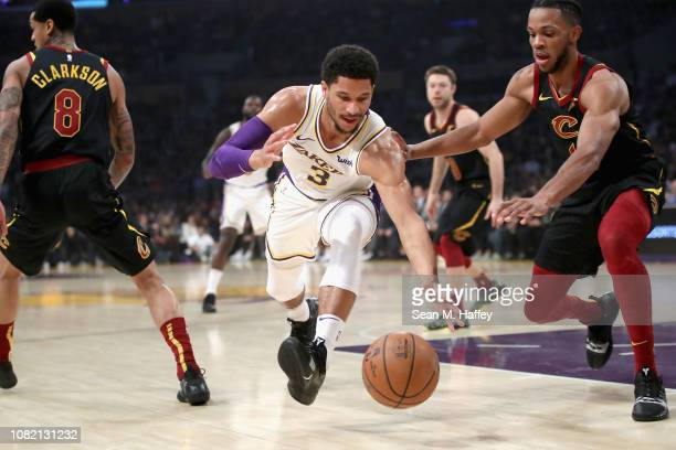 Josh Hart of the Los Angeles Lakers lunges for a loose ball as Jaron Blossomgame of the Cleveland Cavaliers defends during the first half of a game...