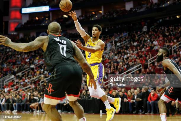 Josh Hart of the Los Angeles Lakers passes the ball defended by James Harden of the Houston Rockets and PJ Tucker in the second half at Toyota Center...