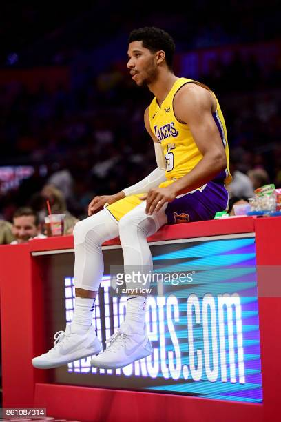 Josh Hart of the Los Angeles Lakers waits to enter the game against the LA Clippers during the first half at Staples Center on October 10 2017 in Los...