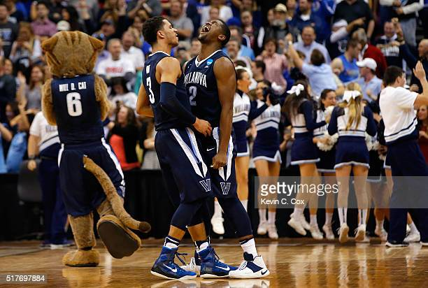 Josh Hart of the Villanova Wildcats and Kris Jenkins celebrate defeating the Kansas Jayhawks 6459 during the 2016 NCAA Men's Basketball Tournament...