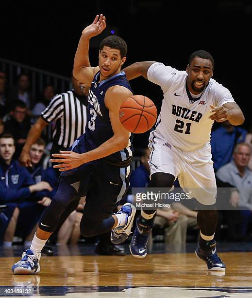 Josh Hart of the Villanova Wildcats and Roosevelt Jones of the Butler Bulldogs chase a loose ball at Hinkle Fieldhouse on February 14 2015 in...