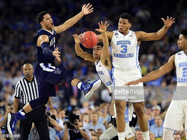 Josh Hart of the Villanova Wildcats battles for the loose ball with Marcus Paige of the North Carolina Tar Heels and Kennedy Meeks in the first half...
