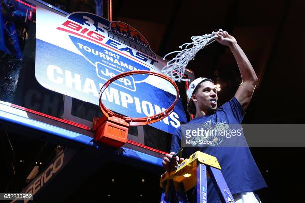 Josh Hart of the Villanova Wildcats cuts the net after defeating the Creighton Bluejays to win the Big East Basketball Tournament - Championship Game...