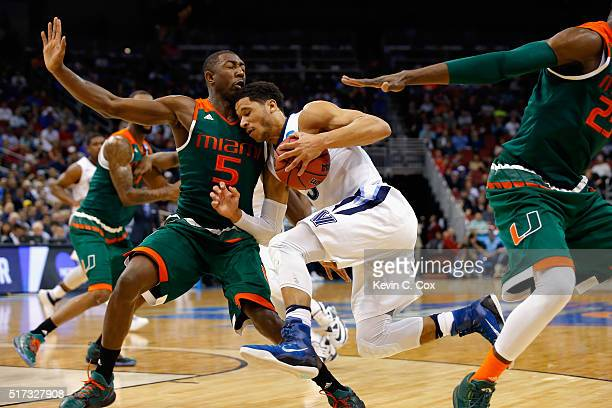 Josh Hart of the Villanova Wildcats drives against Davon Reed of the Miami Hurricanes in the first half of their game during the 2016 NCAA Men's...