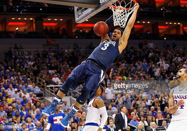 Josh Hart of the Villanova Wildcats dunks the ball in the first half against the Kansas Jayhawks during the 2016 NCAA Men's Basketball Tournament...