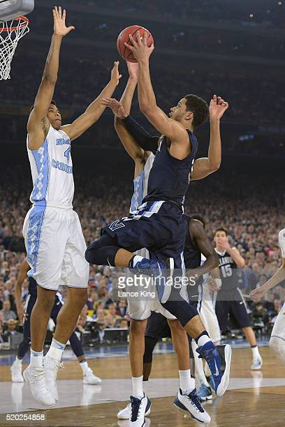 Josh Hart of the Villanova Wildcats goes to the basket against Isaiah Hicks of the North Carolina Tar Heels during the 2016 NCAA Men's Final Four...