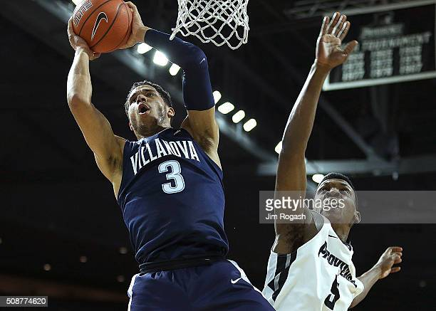Josh Hart of the Villanova Wildcats grabs a rebound from Rodney Bullock of the Providence Friars in the first half on February 6 2016 at the Dunkin'...