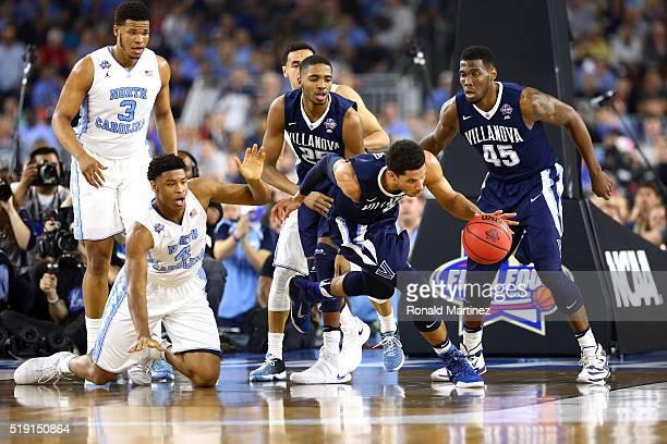 Josh Hart of the Villanova Wildcats handles the ball as Isaiah Hicks of the North Carolina Tar Heels looks on in the first half of the 2016 NCAA...