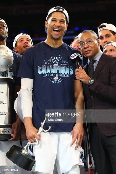 Josh Hart of the Villanova Wildcats holds the Most Outstanding player award after defeating the Creighton Bluejays to win the Big East Basketball...