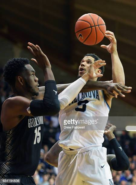 Josh Hart of the Villanova Wildcats is fouled by Jessie Govan of the Georgetown Hoyas at The Pavilion on February 7 2017 in Villanova Pennsylvania...