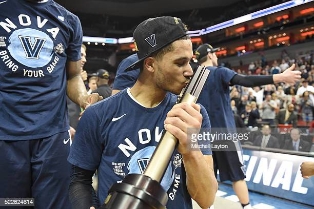 Josh Hart of the Villanova Wildcats kisses the champs trophy after the quarterfinal of the 2016 NCAA Men's Basketball Tournament game against the...