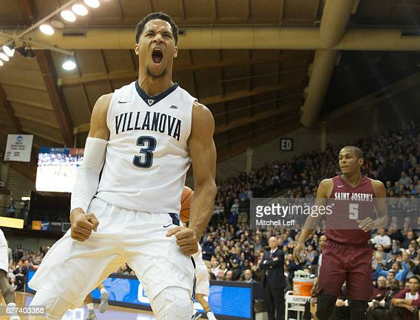 Josh Hart of the Villanova Wildcats reacts in front of Nick Robinson of the Saint Joseph's Hawks in the first half at The Pavilion on December 3 2016...