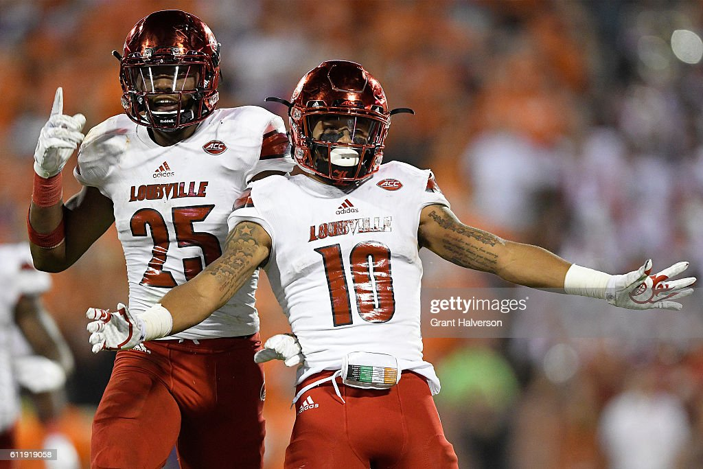 Josh Harvey-Clemons #25 celebrates teammates Jaire Alexander #10 of the Louisville Cardinals fourth quarter interception at Memorial Stadium on October 1, 2016 in Clemson, South Carolina.