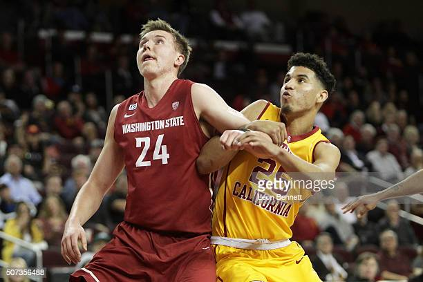 Josh Hawkinson of the Washington Cougars battles for position against Bennie Boatwright of the USC Trojans during a NCAA Pac12 college basketball...