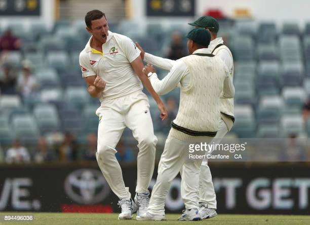Josh Hazelwood of Australia celebrates taking the wicket of Jonny Bairstow of England during day five of the Third Test match during the 2017/18...