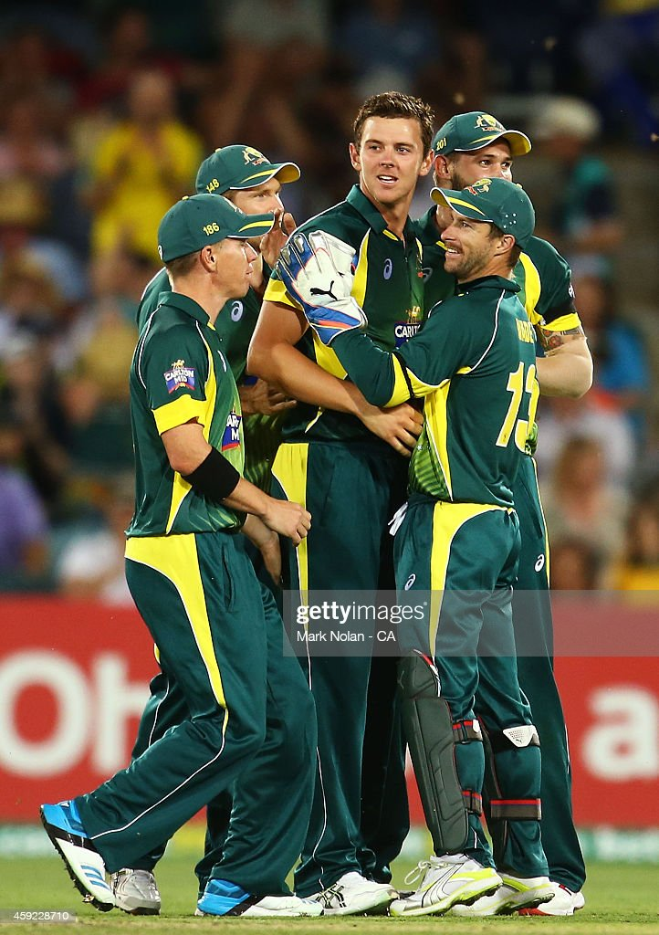 Josh Hazelwood of Australia celebrates with team mates after taking a wicket during game three of the One Day International Series between Australia and South Africa at Manuka Oval on November 19, 2014 in Canberra, Australia.