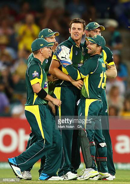 Josh Hazelwood of Australia celebrates with team mates after taking a wicket during game three of the One Day International Series between Australia...