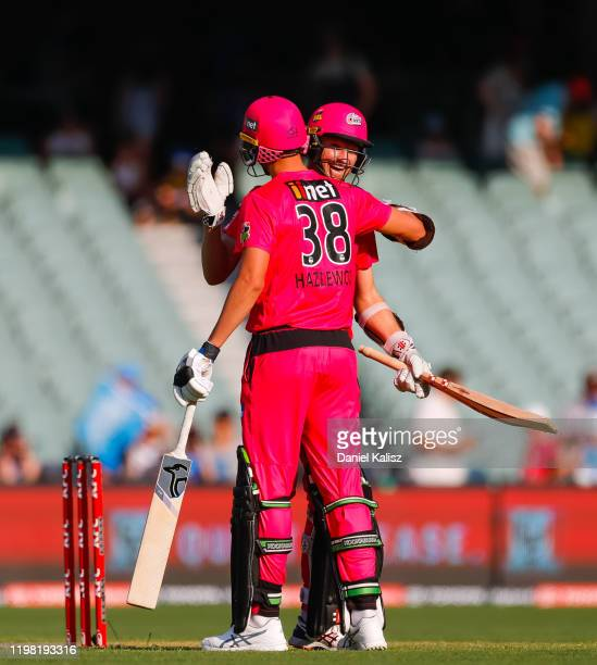 Josh Hazelwood of the Sixers and Jackson Bird of the Sixers celebrate during the Big Bash League match between the Adelaide Strikers and the Sydney...