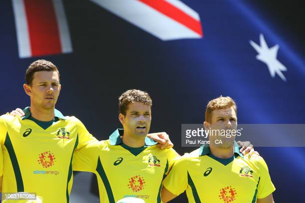 Josh Hazlewood Alex Carey and Aaron Finch of Australia look on while Australian national anthem is performed during game one of the One Day...