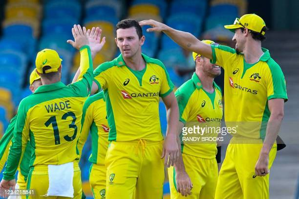 Josh Hazlewood and Mitchell Starc of Australia celebrate the dismissal of Alzarri Joseph of West Indies during the 3rd and final ODI between West...
