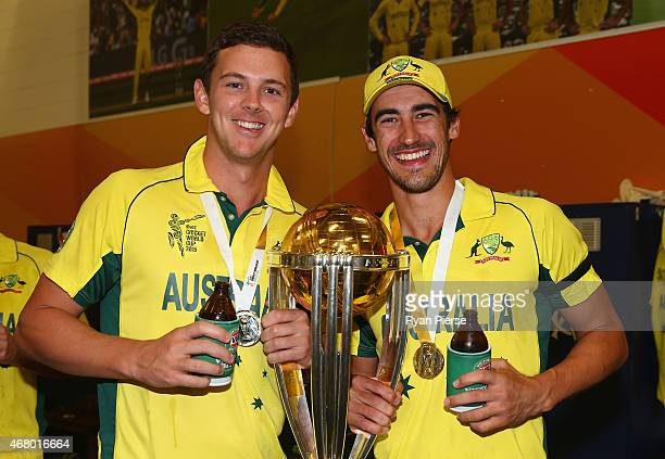 Josh Hazlewood and Mitchell Starc of Australia celebrate with the trophy during the 2015 ICC Cricket World Cup final match between Australia and New...