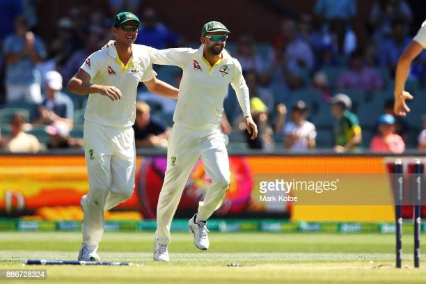 Josh Hazlewood and Nathan Lyon of Australia celebrate victory during day five of the Second Test match during the 2017/18 Ashes Series between...