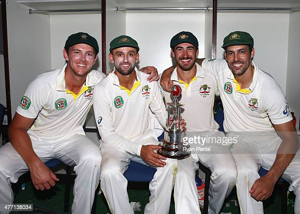 Josh Hazlewood Nathan Lyon Mitchell Starc and Mitchell Johnson of Australia pose with the Frank Worrell Trophy in the change rooms after day four of...