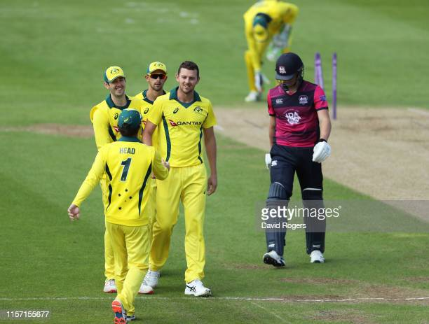 Josh Hazlewood of Australia A celebrates with team mates after taking the wicket of Jack Blatherwick during the Tour Match between Northamptonshire...