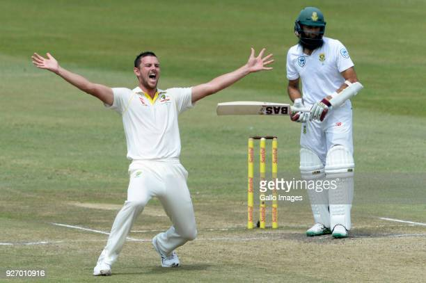 Josh Hazlewood of Australia appeals for the wicket of Hashim Amla of the Proteas during day 4 of the 1st Sunfoil Test match between South Africa and...