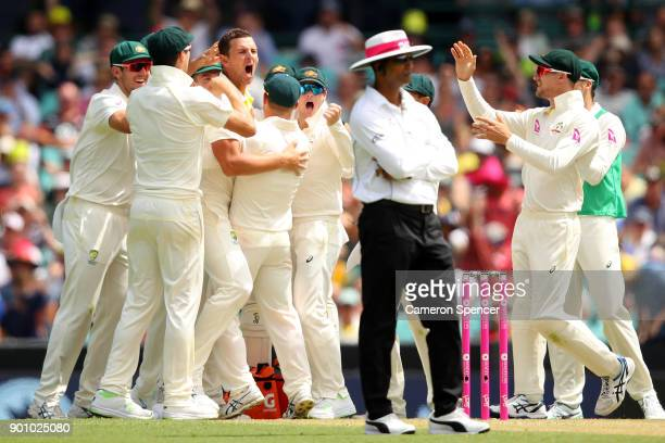 Josh Hazlewood of Australia celebrates a DRS decision taking the wicket of Alastair Cook of England for lbw during day one of the Fifth Test match in...