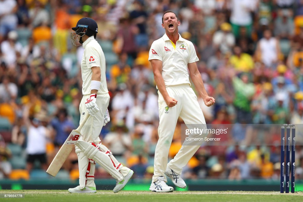 Josh Hazlewood of Australia celebrates after taking the wicket of Joe Root of England during day four of the First Test Match of the 2017/18 Ashes Series between Australia and England at The Gabba on November 26, 2017 in Brisbane, Australia.