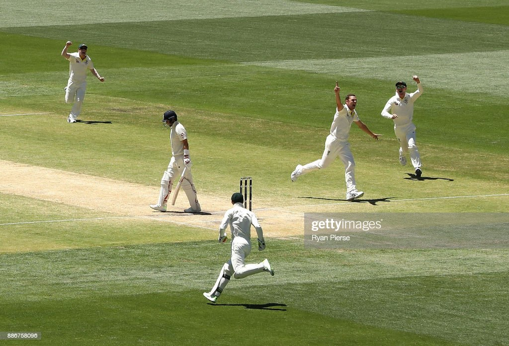 Josh Hazlewood of Australia celebrates after taking the wicket of Joe Root of England during day five of the Second Test match during the 2017/18 Ashes Series between Australia and England at Adelaide Oval on December 6, 2017 in Adelaide, Australia.