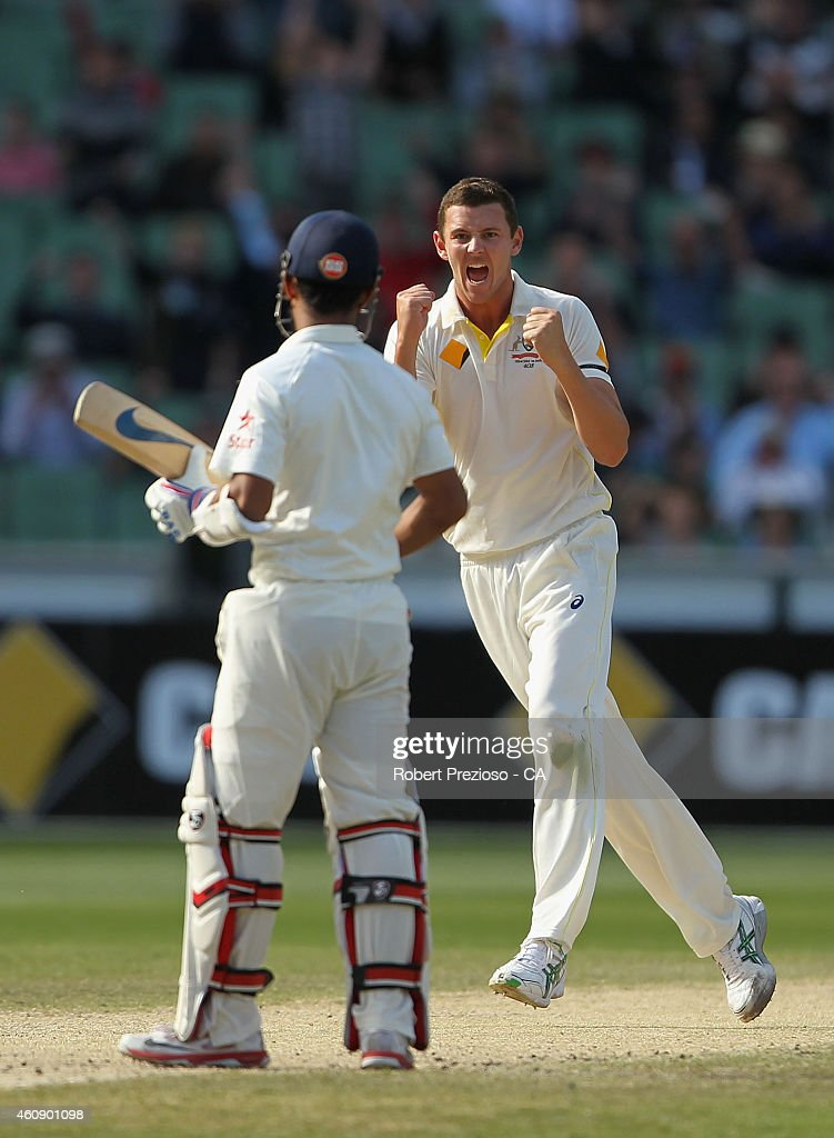Josh Hazlewood of Australia celebrates after taking the wicket of Ajinkya Rahane of India during day five of the Third Test match between Australia and India at Melbourne Cricket Ground on December 30, 2014 in Melbourne, Australia.