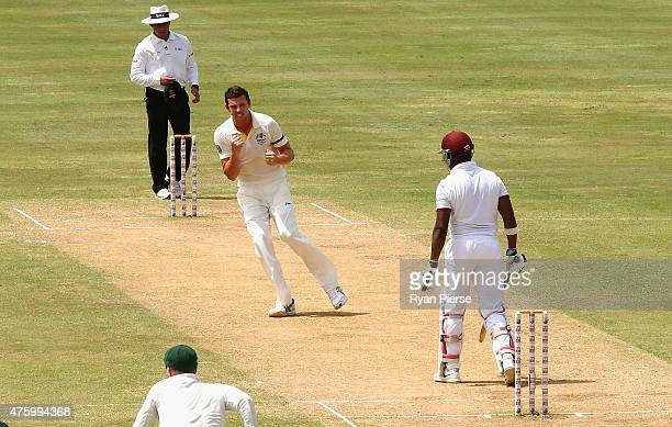 Josh Hazlewood of Australia celebrates after taking the wicket of Darren Bravo of West Indies during day three of the First Test match between...
