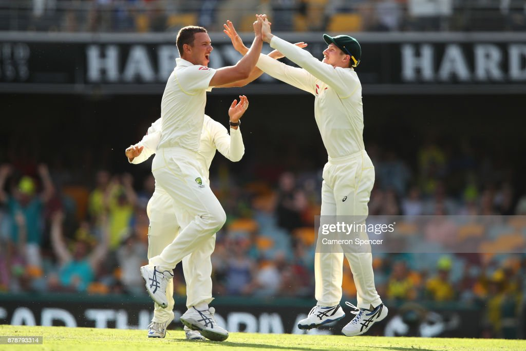 Josh Hazlewood of Australia celebrates after taking the wicket of James Vince of England during day three of the First Test Match of the 2017/18 Ashes Series between Australia and England at The Gabba on November 25, 2017 in Brisbane, Australia.