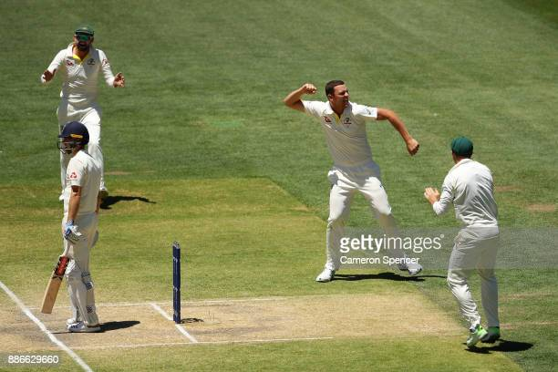 Josh Hazlewood of Australia celebrates after taking the wicket of Chris Woakes of England during day five of the Second Test match during the 2017/18...