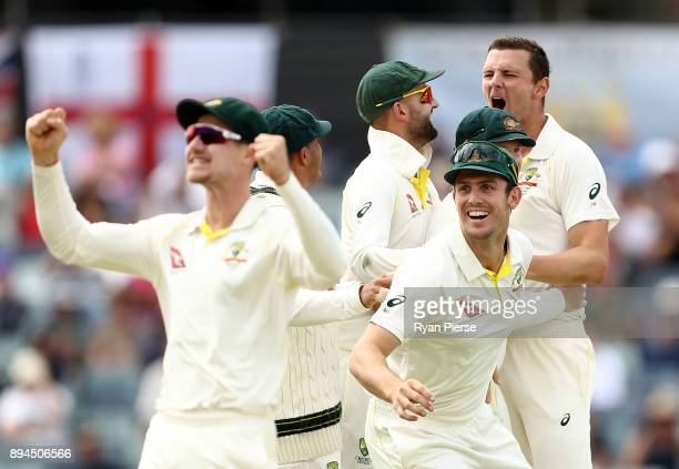 Josh Hazlewood of Australia celebrates after taking the wicket of Dawid Malan of England during day five of the Third Test match during the 2017/18...
