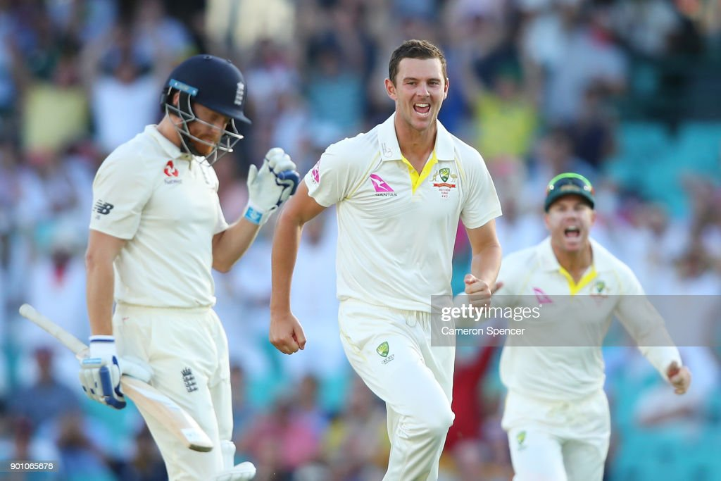 Josh Hazlewood of Australia celebrates after taking the wicket of Jonny Bairstow of England during day one of the Fifth Test match in the 2017/18 Ashes Series between Australia and England at Sydney Cricket Ground on January 4, 2018 in Sydney, Australia.